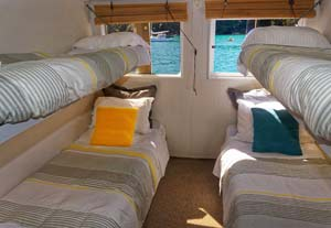 Backpacker dorm accommodation on a boat in the Abel Tasman National Park