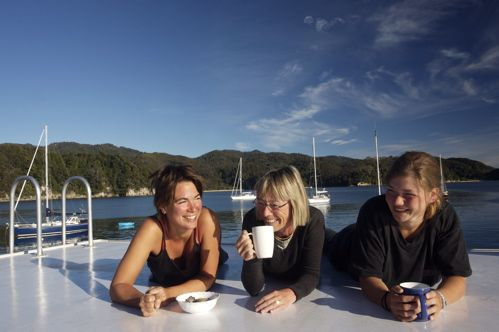 Enjoy a morning cup of coffee on your floating accommodation