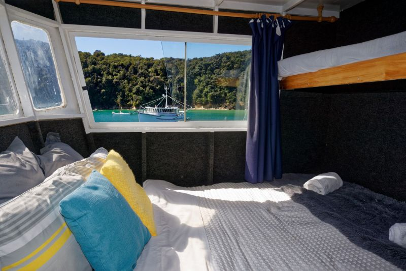 Private cabin accommodation aboard Aquapackers in the Abel Tasman, Nelson, New Zealand